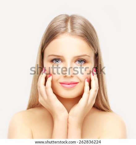 Close-up, beauty portrait of a smiling, beautiful blonde woman  - stock photo