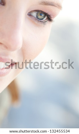 Close up beauty portrait of a young caucasian healthy woman eye looking down with lush and long eyelashes. - stock photo
