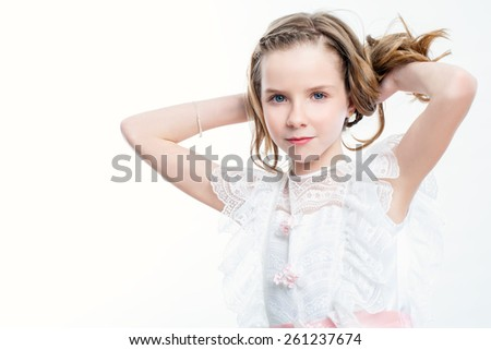 Close up beauty portrait of attractive child in white dress. - stock photo