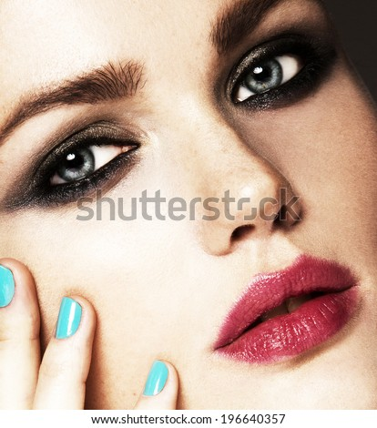 Close-up beauty portrait of beautiful model with bright make-up and manicure. Smoky eyes