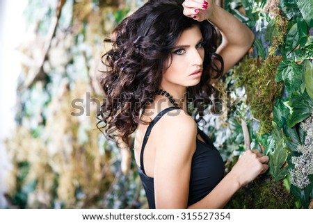 Close-up beauty portrait of gorgeous brunette woman with perfect makeup and hairstyle - stock photo