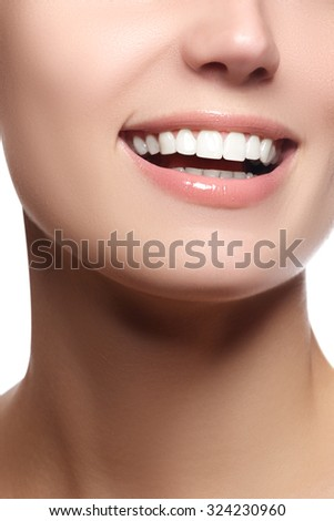 Close up beauty portrait view of a young woman natural smile with pink lips smiling with white teeth. Beautiful wide smile of young woman with great healthy white teeth. Isolated over white background - stock photo