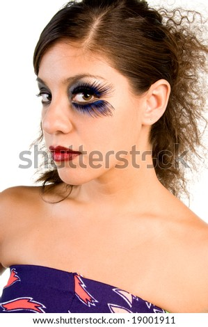 Close up beauty shot of a High fashion model in runway makeup with feather eyelashes creating a butterfly eye