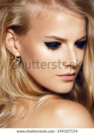 close-up beauty shot of young pretty model with bright make-up. Dark eyes. Eyeliner  - stock photo