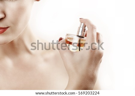 Close up beauty woman portrait with parfume against white - stock photo
