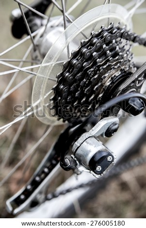 Close up bike chain gear shot on the beach . Outdoors, nautical, biking, urban living, cross fitness and adventure background concept - stock photo