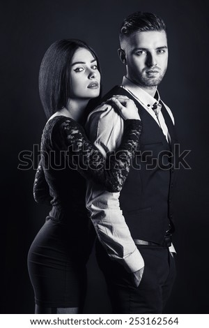 Close up black and white portrait of a loving couple. Young man and woman - stock photo