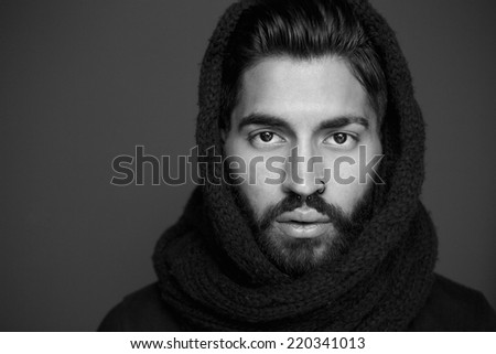Close up black and white portrait of a man with wool scarf