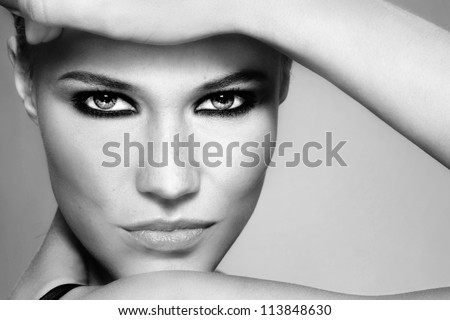 Close-up black and white portrait of beautiful stylish blonde girl with trendy make-up - stock photo
