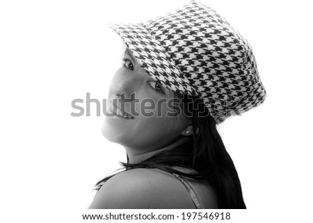 Close up black and white shot of pretty girl wearing a vintage checkered cap - stock photo