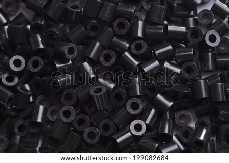 close up black beads heap isolated on white