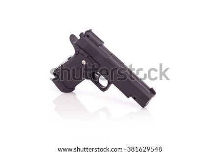 Close up black gun isolated on white background - stock photo
