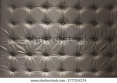 Close up black luxury buttoned leather. - stock photo