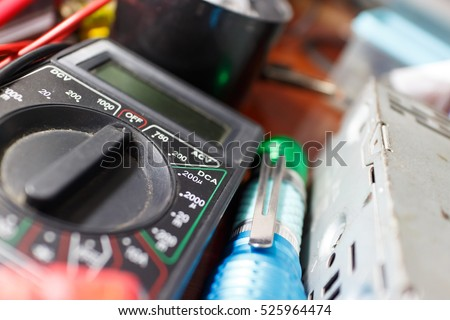 close up black multimeter on work table with equipment