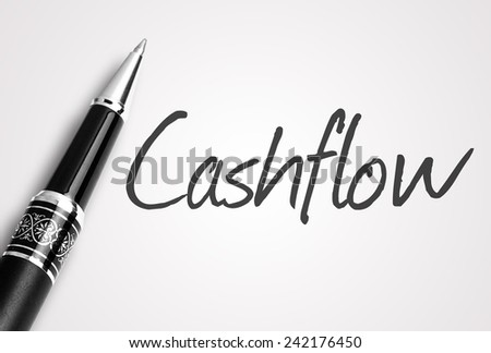 Close up black pen writes cashflow on paper  - stock photo
