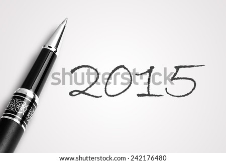 Close up black pen writes 2015 on paper  - stock photo