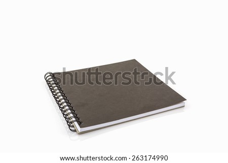 Close up black sketch book on white background. - stock photo