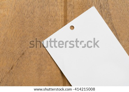 Close up blank price tag on wood background