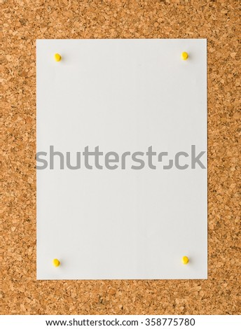 close up blank white paper note sheet with yellow push pin on cork board background for