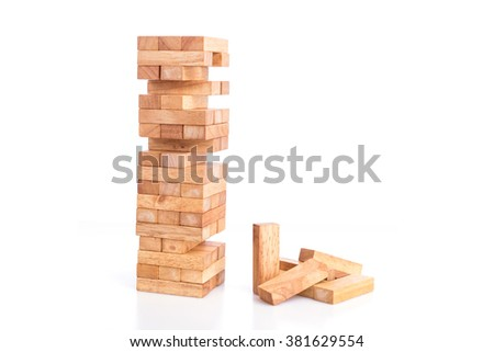 Close up blocks wood game (jenga) isolated on white background - stock photo