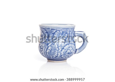 Close up blue ceramic cup isolated on white background