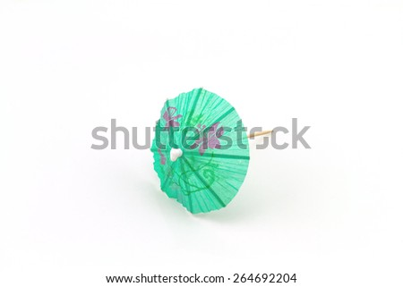 Close up blue cocktail umbrellas on white   background - stock photo