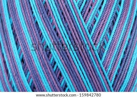 close up blue color thread in spool - stock photo
