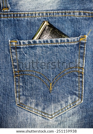 Close up blue jeans pocket with wallet. - stock photo