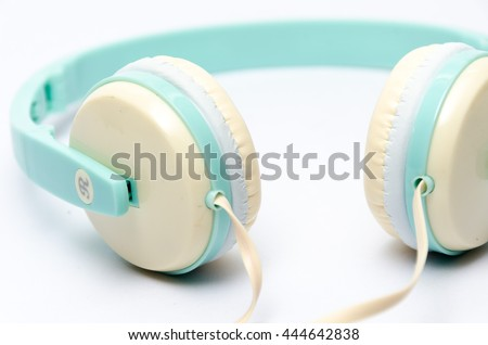 Close up Blue pastel Headphones. Isolated on white background ,The letters L and R to the left ear, right ear.