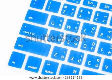 Close up blue transparent Thai keyboard cover - stock photo