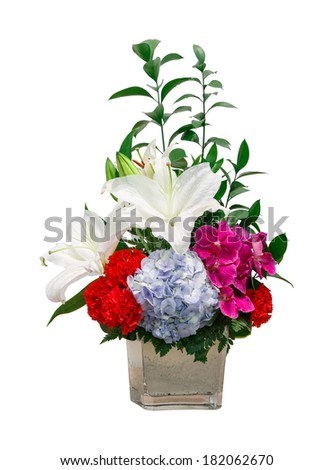 close up bouquet of lily - hydrangea - vanda - foot fern - carnation flower in glass vase isolated on white