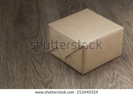 Close up box on wooden table - stock photo