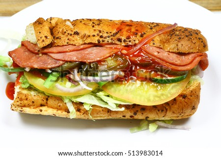 Close up bread delicious sandwich with lettuce,tomato,beef,vegetable,chili,pickled,garlic isolated on white
