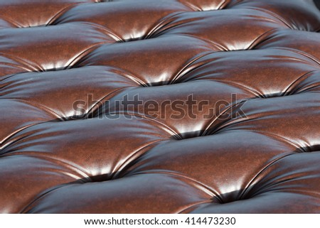 Close up brown leather sofa texture background with shallow depth of field for a luxury decoration in modern building  - stock photo