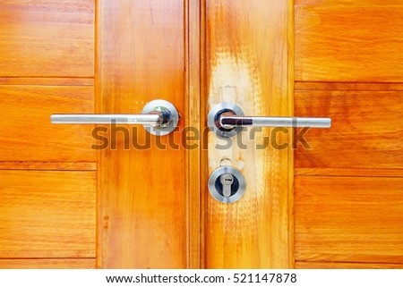 Close up brown modern wooden door with handle