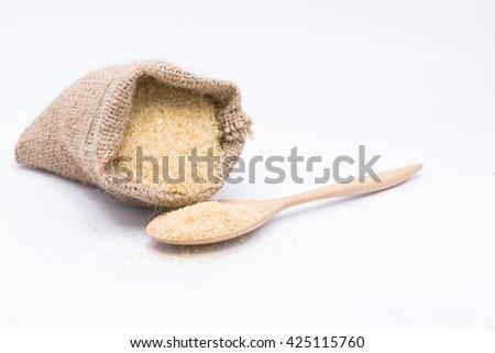 Close up brown Sugar.brown sugar in spoon.brown sugar in wooden spoon.  brown sugar. .brown sugar. brown sugar from sugar cane. brown sugar.natural brown sugar.brown sugar. - stock photo