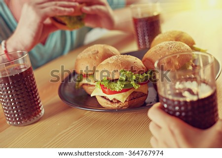Close up burgers and cola on the table served for party