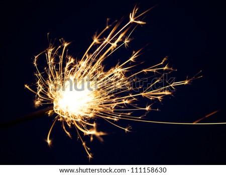 close up burning christmas sparkler - stock photo