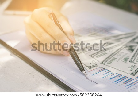 Close-up, Business financial working.,woman with a money.