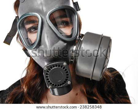 Close up, business looking young adult woman posing on a personal gas mask on her face - white background