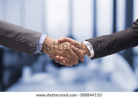 close up business man handshake together on blur meeting room background in :agreement,accept,approve financial cooperative concept.improve/development.trust,goal,team,hand,shake:international  invest - stock photo