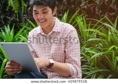close up business man holding tablet for checking email