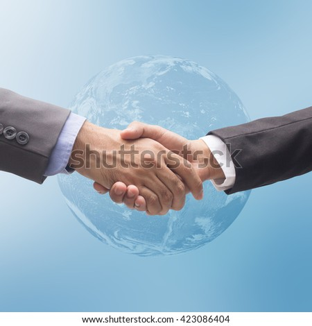 close up business man in suit clothes are handshake on world map background:gesture hand shake for accomplishment goal together:long term financial worldwide:visionary motivation achievement.fulfill - stock photo