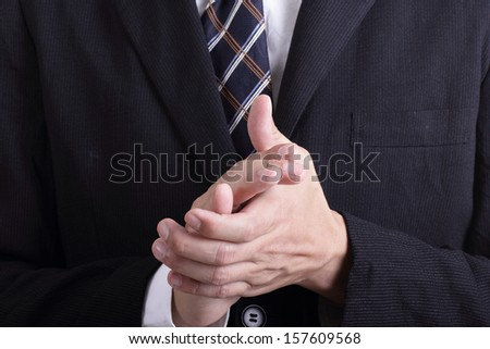 Close up businessman clapping his hands in the office