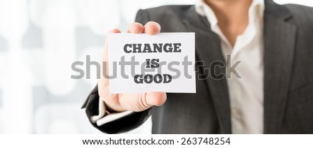 Close up Businessman in Business Suit Showing Small White Card with Change is Good Message. - stock photo