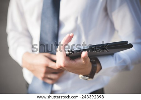 close up businessman man hand using tablet device outdoor