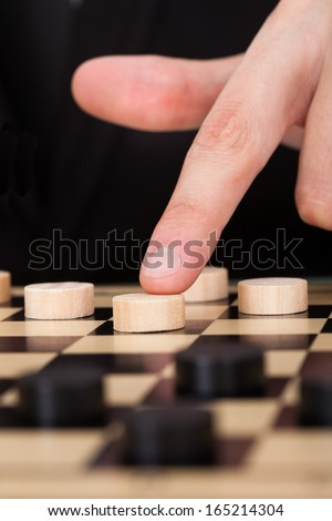 Close-up Businessman Playing Checkers At Office Desk