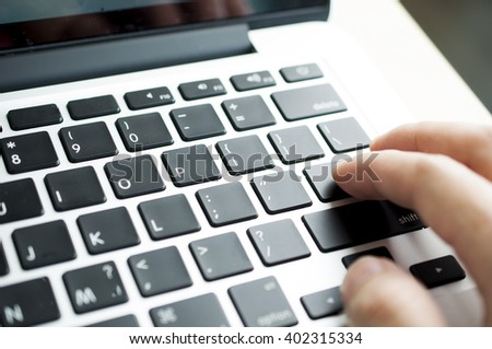 Close up businessman's hand push on keyboard