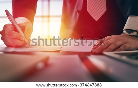 Close up businessman signing documents. - stock photo