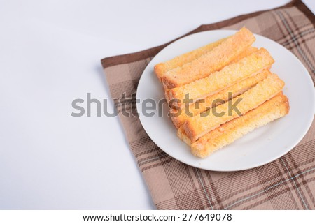 Close up Butter toast bread on Dish , Selective focus - stock photo